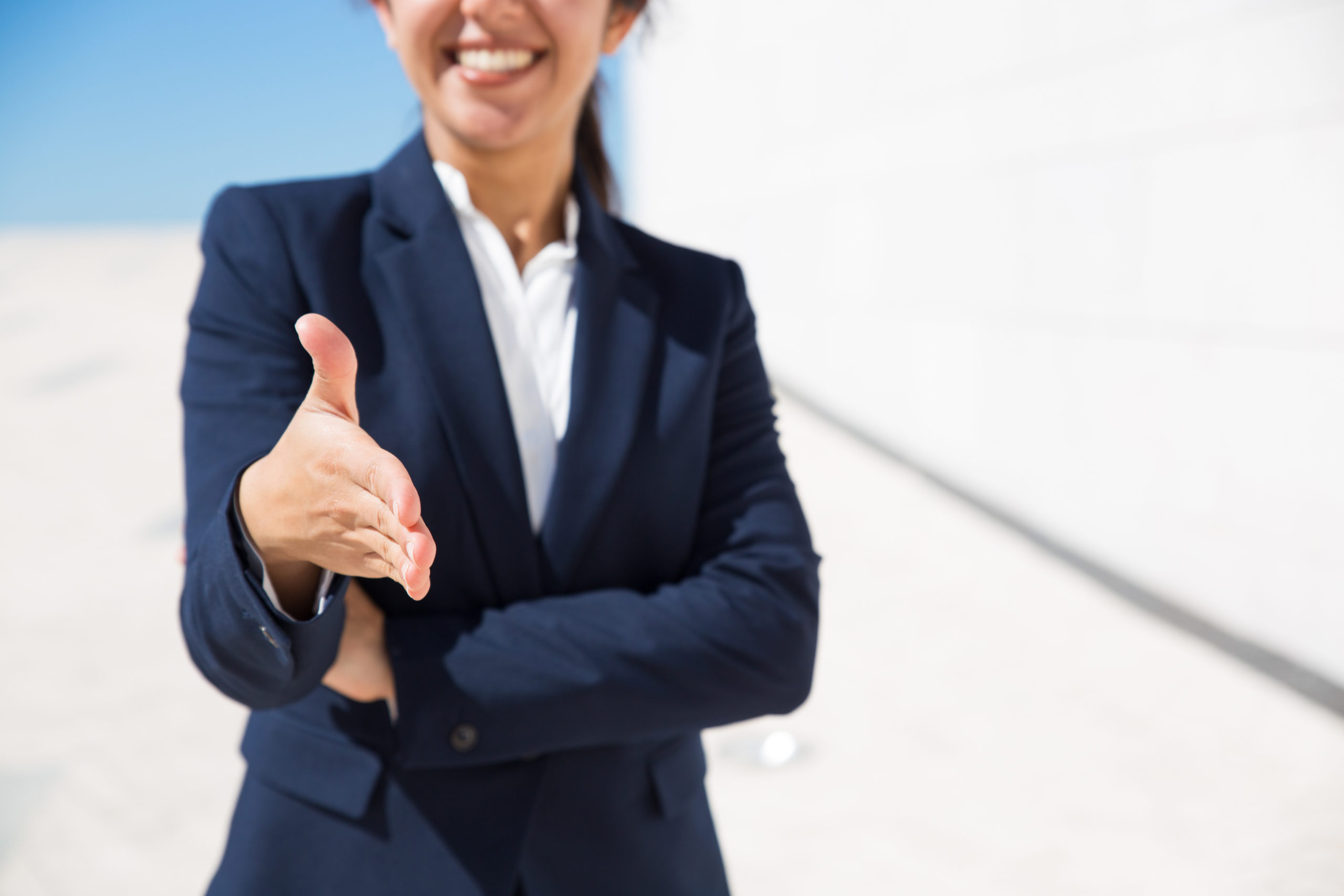 smiling hr manager congratulating with getting job scaled